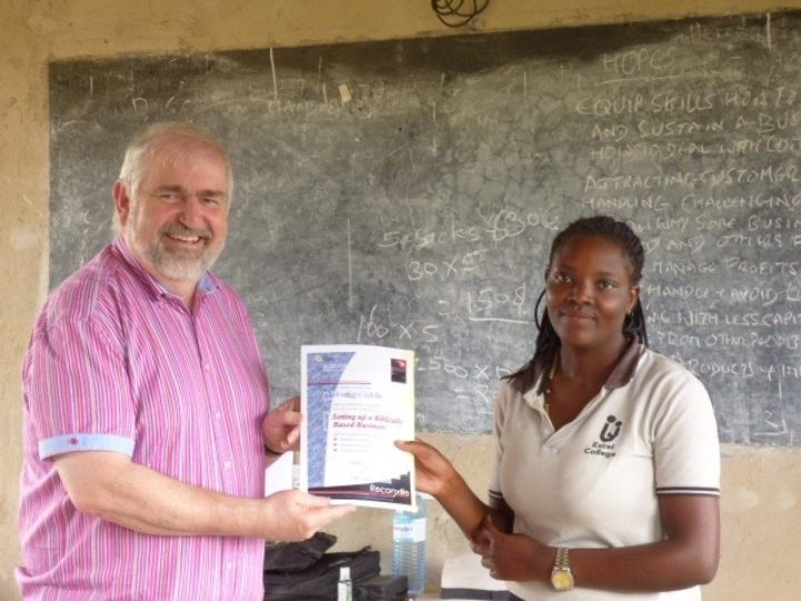 Mike awarding a certificate for completed training